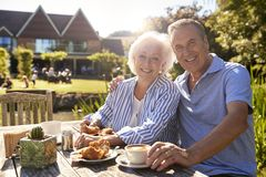 Portrait Of Senior Couple Enjoying Outdoor Summer Snack At Cafe stock images