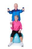 Portrait of a senior couple exercising Stock Photo
