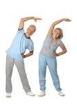 Portrait of Senior Couple Exercising Stock Photos