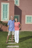 Portrait Of Senior Couple In Front Of House Stock Photos