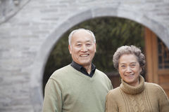 Portrait of senior couple in front of round arch, Beijing Royalty Free Stock Images