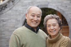 Portrait of senior couple in front of round arch, Beijing Royalty Free Stock Photo
