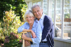 Portrait of senior couple by greenhouse Stock Photography