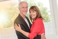 Portrait of a happy senior couple, light effect stock images