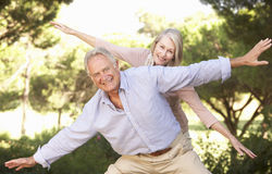 Portrait Of Senior Couple Having Fun In Countryside royalty free stock image