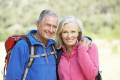 Portrait Of Senior Couple On Hike Stock Photo