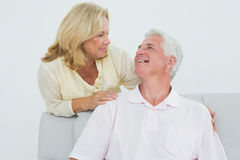 Portrait of a senior couple at home. Portrait of a senior men and women in living room at home Royalty Free Stock Photo