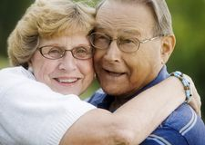 Portrait Of Senior Couple Hugging Stock Photography