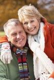Portrait Of Senior Couple Hugging stock photo