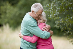 Portrait of a senior couple hugging, outdoors Stock Images