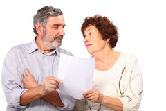 Portrait of senior couple with list of paper Stock Photos