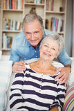 Portrait of senior couple in living room Royalty Free Stock Image