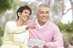 Portrait Of Senior Couple Looking At Map. Portrait Of Senior Asian Couple Looking At Map Stock Images