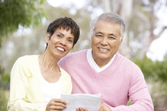 Portrait Of Senior Couple Looking At Map. Portrait Of Senior Asian Couple Looking At Map Royalty Free Stock Photo