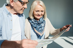 Portrait of senior couple looking at traveling map Stock Image
