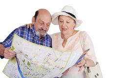 Portrait of senior couple with map looking sights. stock photo
