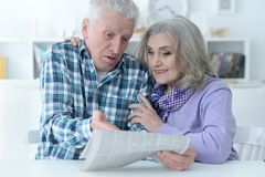 Portrait of a senior couple with newspaper royalty free stock image