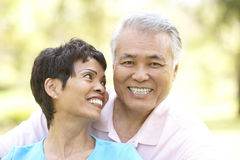 Portrait Of Senior Couple In Park Royalty Free Stock Image