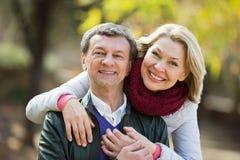 Portrait of senior couple in park Stock Image