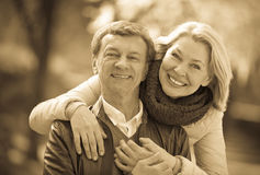 Portrait of senior couple in park Stock Photography