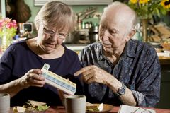 Portrait of Senior Couple with Pill Case Royalty Free Stock Image