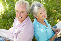 Portrait of senior couple reading Stock Images
