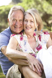 Portrait Of Senior Couple Relaxing In Countryside Royalty Free Stock Image