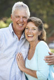 Portrait Of Senior Couple Relaxing In Park Stock Photos