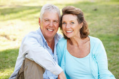 Portrait Of Senior Couple Relaxing In Park Stock Images