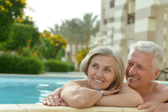 Couple relaxing in  pool Royalty Free Stock Image