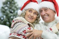 Portrait of senior couple in Santa hats. Portrait of happy senior couple in Santa hats royalty free stock photo