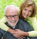 Portrait of a senior couple smiling together outdoors royalty free stock photography