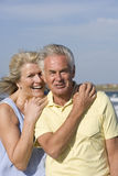 Portrait of senior couple standing on beach stock photography