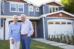 Portrait Of Senior Couple Standing Outside House Stock Images