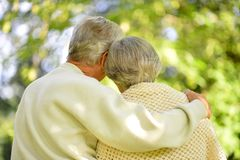 Portrait of senior couple standing in summer park royalty free stock images