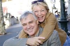 Portrait of senior couple in town having fun Stock Photos