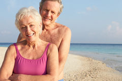 Portrait Of Senior Couple On Tropical Beach Holiday. Smiling To Camera Stock Photography