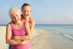 Portrait Of Senior Couple On Tropical Beach Holiday. Smiling To Camera Stock Images
