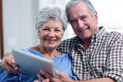 Portrait of senior couple using a digital tablet Stock Photo