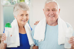 Portrait of senior couple after a workout. Portrait of senior couple smiling after a workout Royalty Free Stock Images