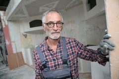 Portrait of senior craftsman on construction site Stock Photography