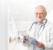 Portrait of senior doctor on hospital corridor stock images