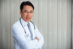 Portrait of senior doctor in medical office royalty free stock photos