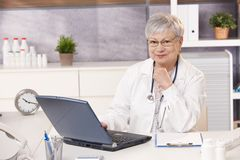 Portrait of senior doctor in office Royalty Free Stock Image