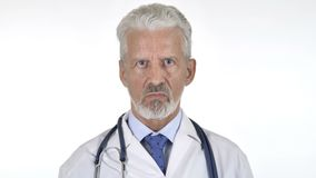 Portrait of Senior Doctor Shaking Head To Reject, White Background