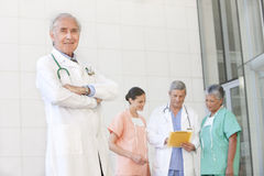Portrait of senior doctor with staff Stock Photography