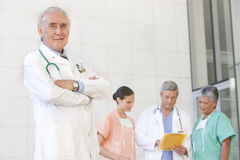 Portrait of senior doctor and staff royalty free stock photos