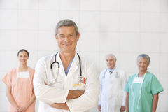 Portrait of senior doctor with staff stock photo