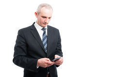 Portrait of senior elegant man holding texting on smartphone Royalty Free Stock Photos