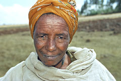 Portrait of senior Ethiopian woman with flies Royalty Free Stock Images